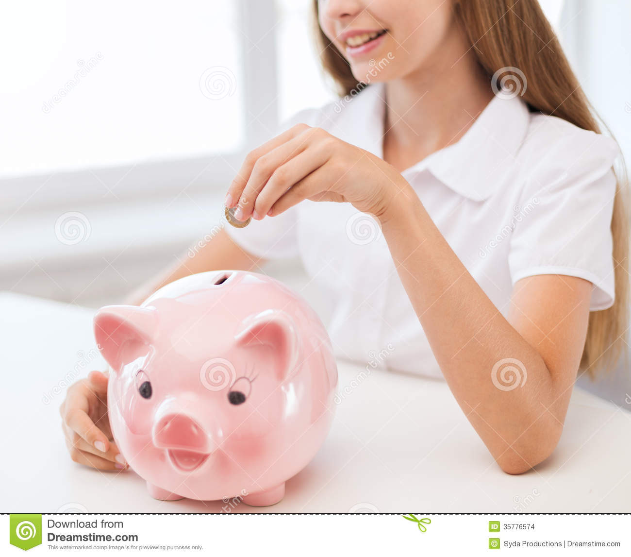 Smiling child putting coin into big piggy bank stock photo for Childrens piggy bank
