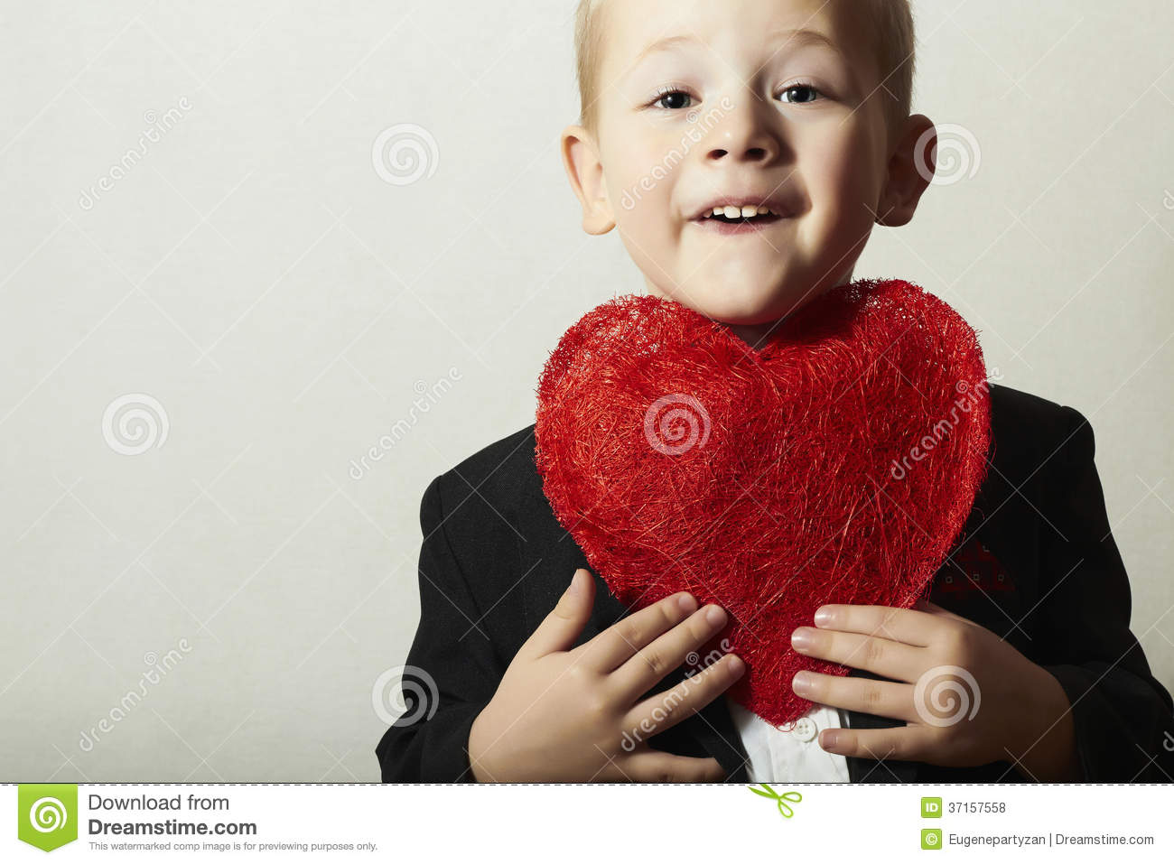 Smiling child with red heart funny boy with heart symbol lovely royalty free stock photo buycottarizona Images