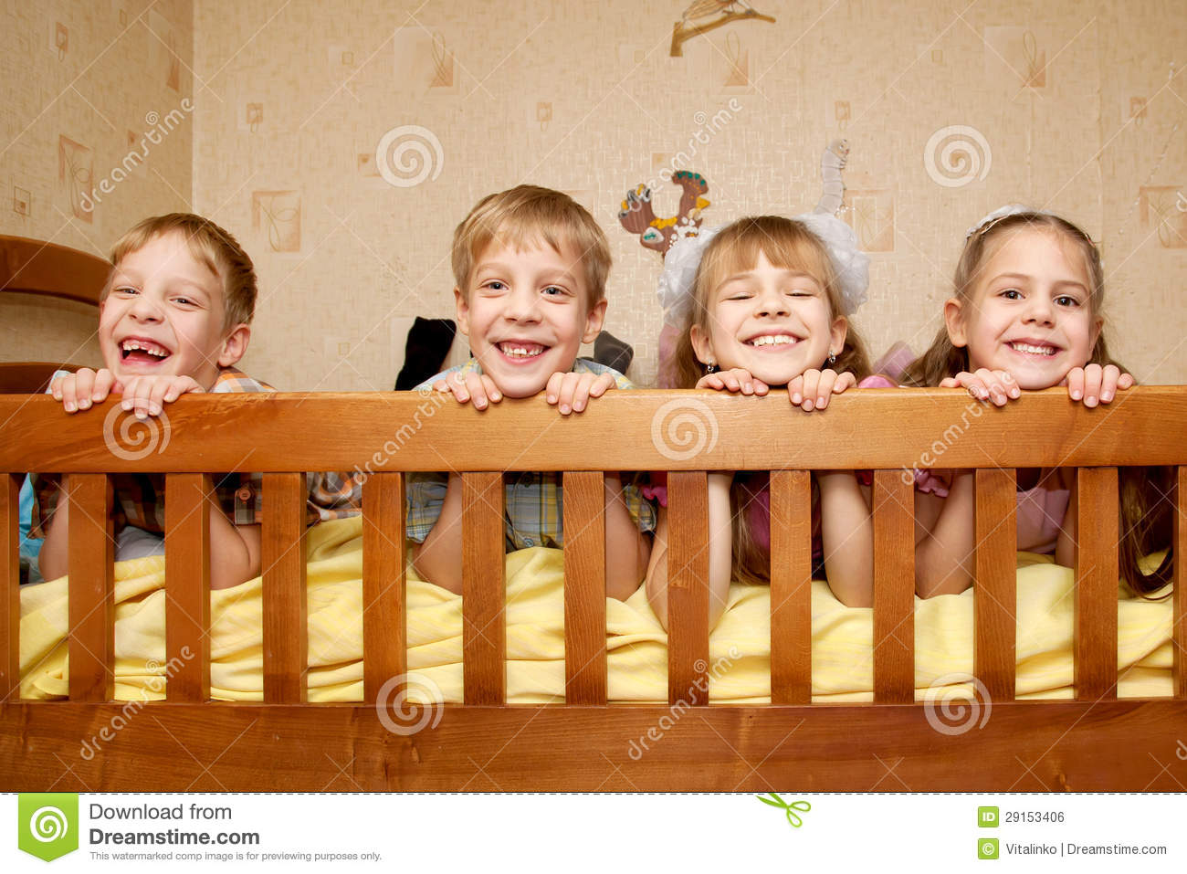 smiling children brothers and sisters lying on bed stock photo image of cute group 29153406. Black Bedroom Furniture Sets. Home Design Ideas