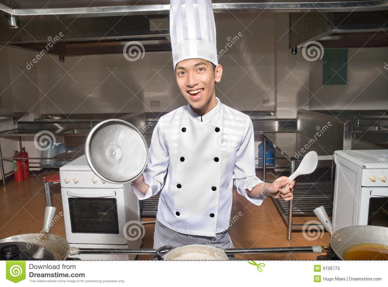 Smiling Chinese Cook In Kitchen