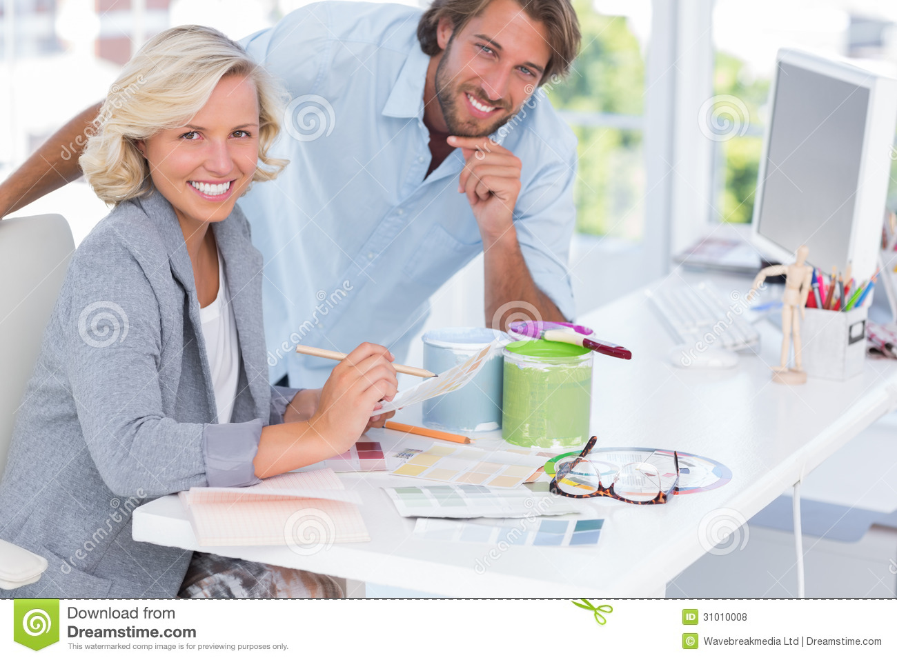 Male Interior Designers At Work young man and female colleagues working together stock photo