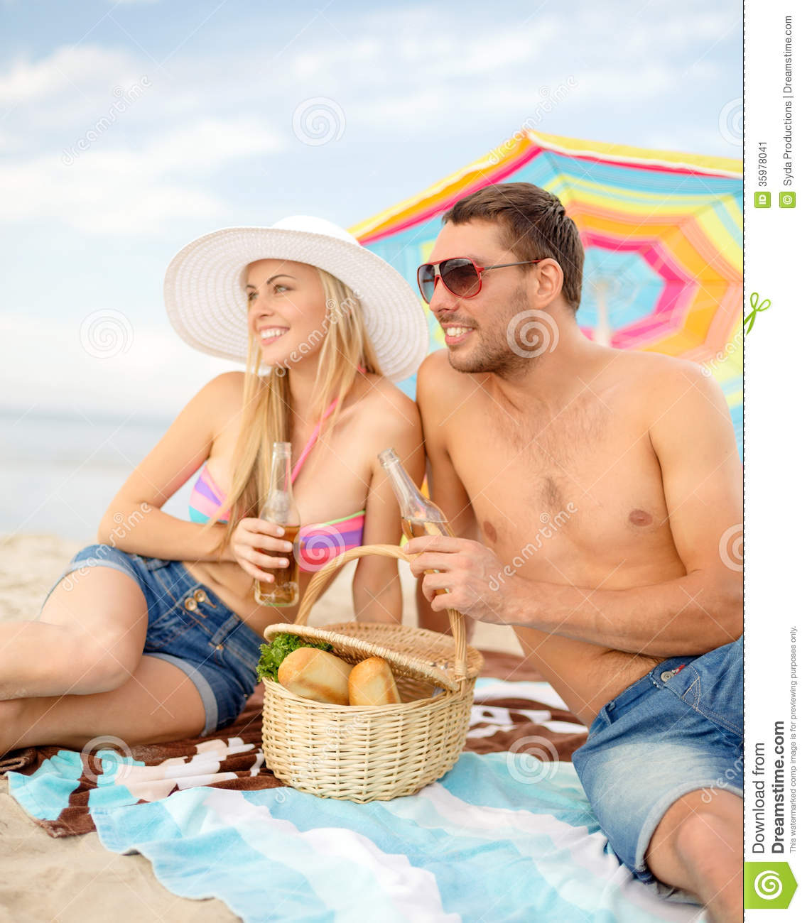 Colorful Beach Condo Makeover: Smiling Couple Having Picnic On The Beach Stock Image