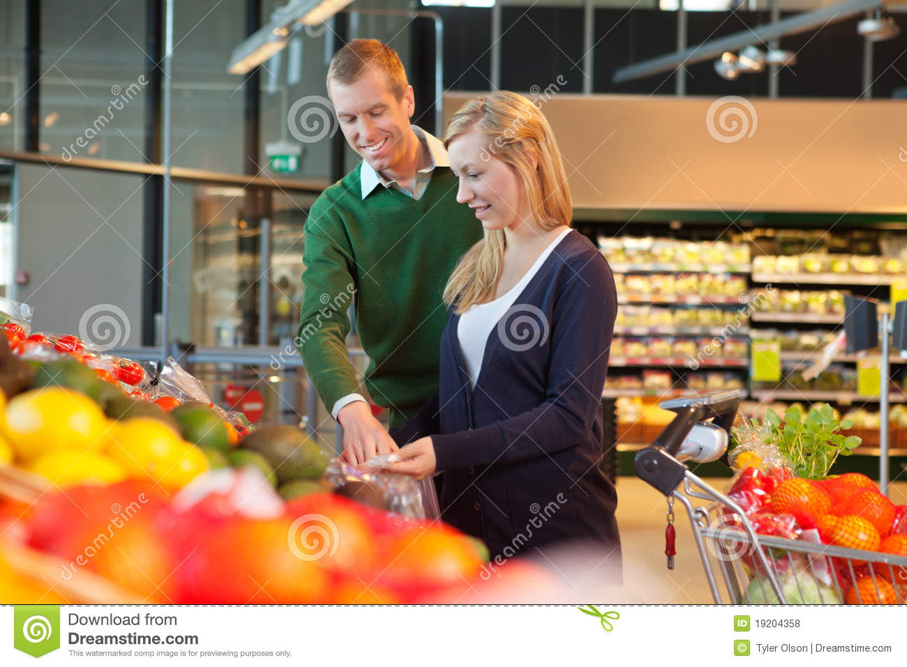Smiling couple in shopping store