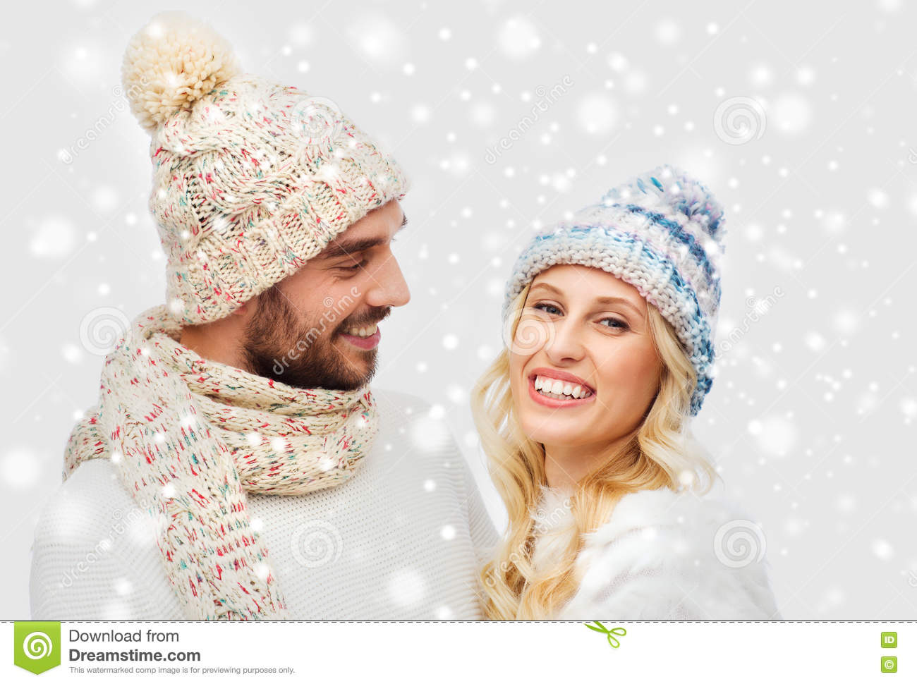 c3f202e6277 Smiling Couple In Winter Clothes Hugging Over Snow Stock Photo ...