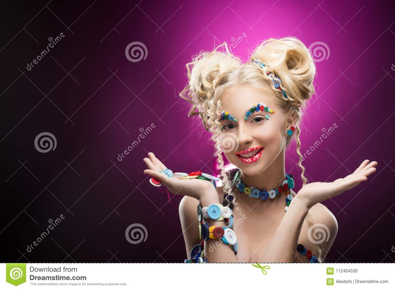 Smiling cute face nice blonde child girl wearing DIY bijou accessories made of multi-colored buttons holds blank copy space on he