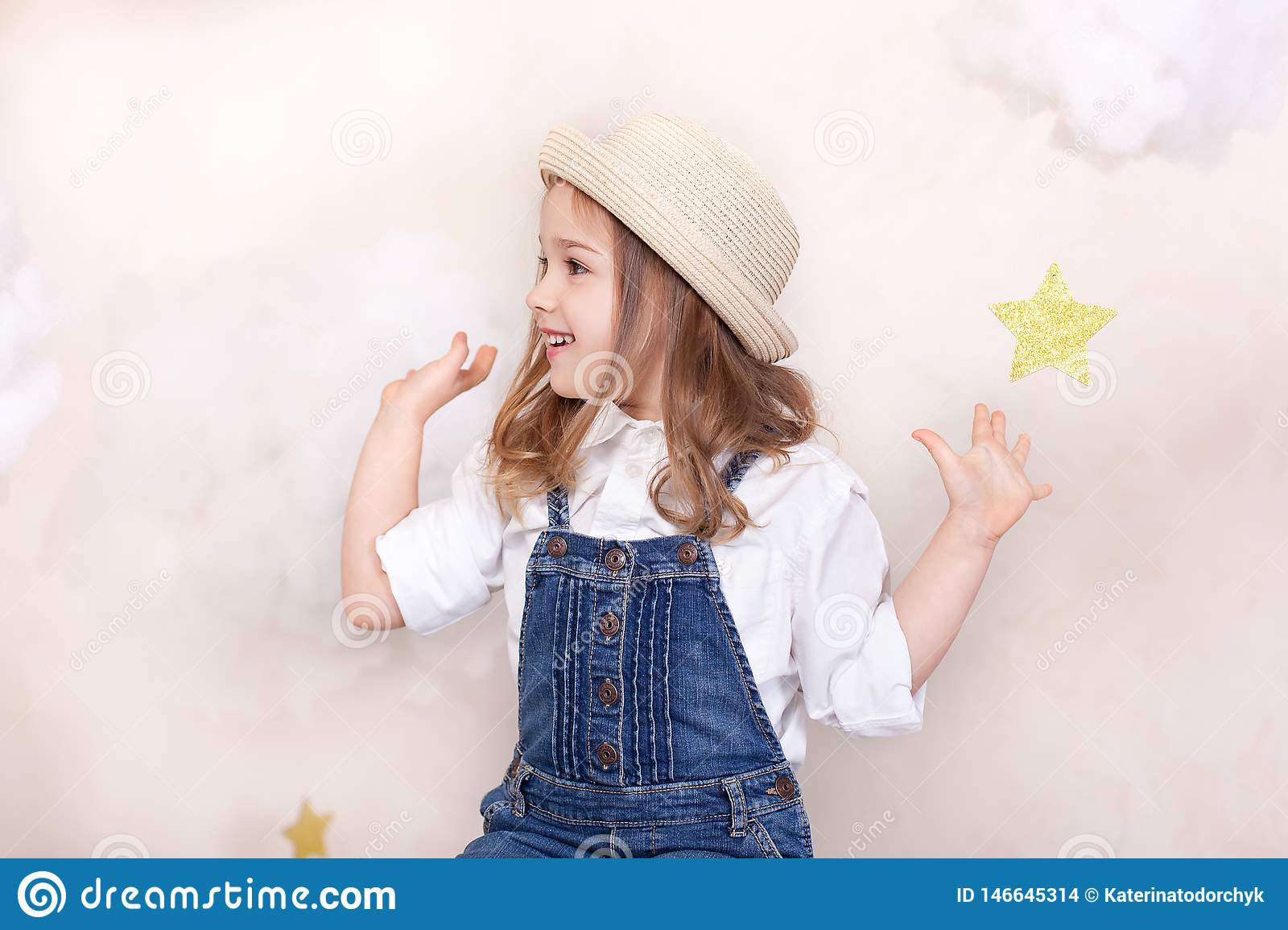 A smiling cute little girl flies in the sky with clouds and stars. Little astrologer Little traveler. The concept of preschool edu