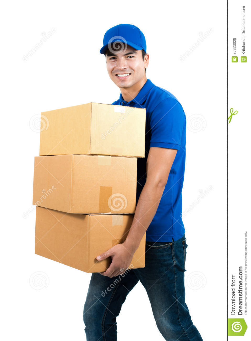 Smiling delivery man holding boxes