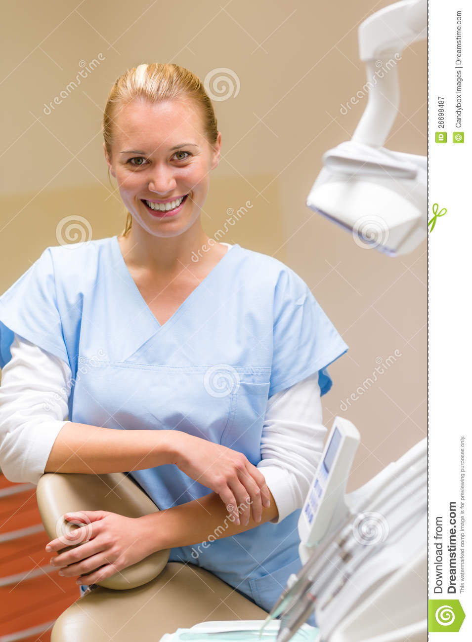 Smiling Dental Nurse In Surgery Office Royalty Free Stock ...