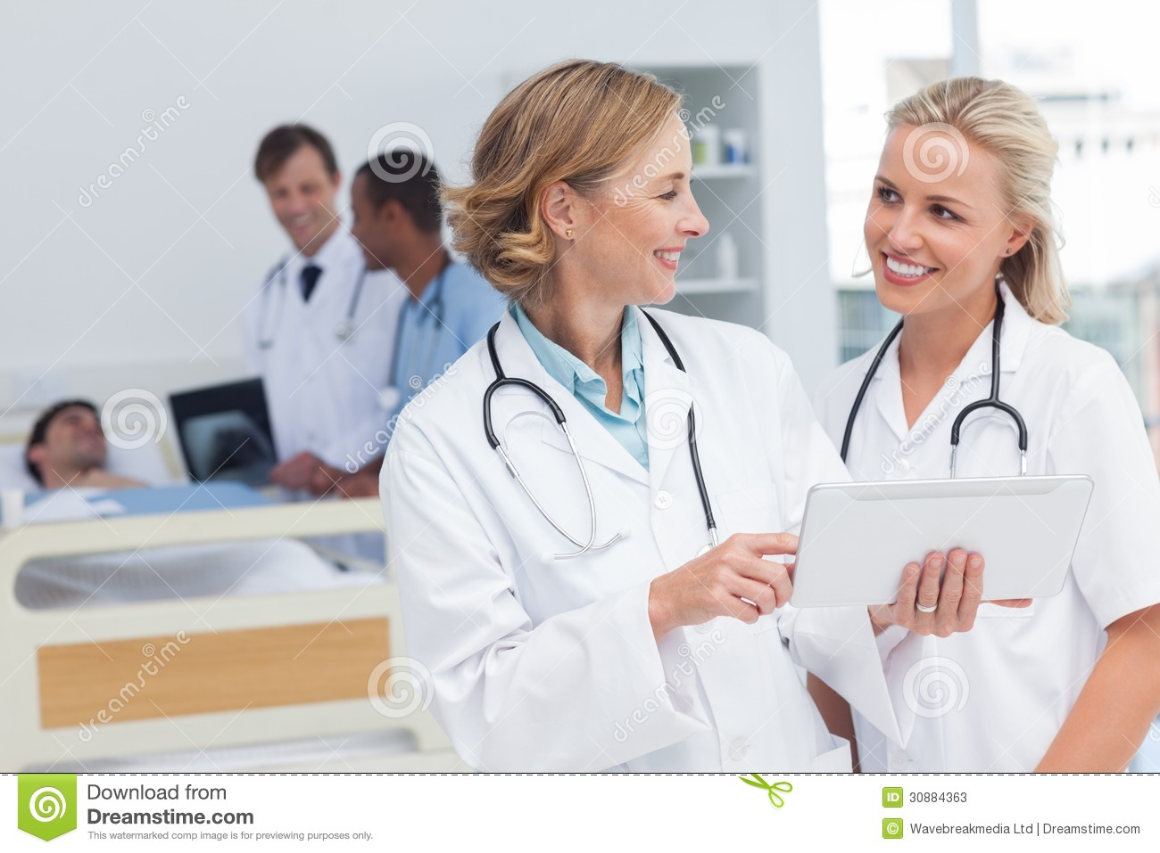 Smiling Doctors Talking To Each Other Stock Photos - Image: 30884363