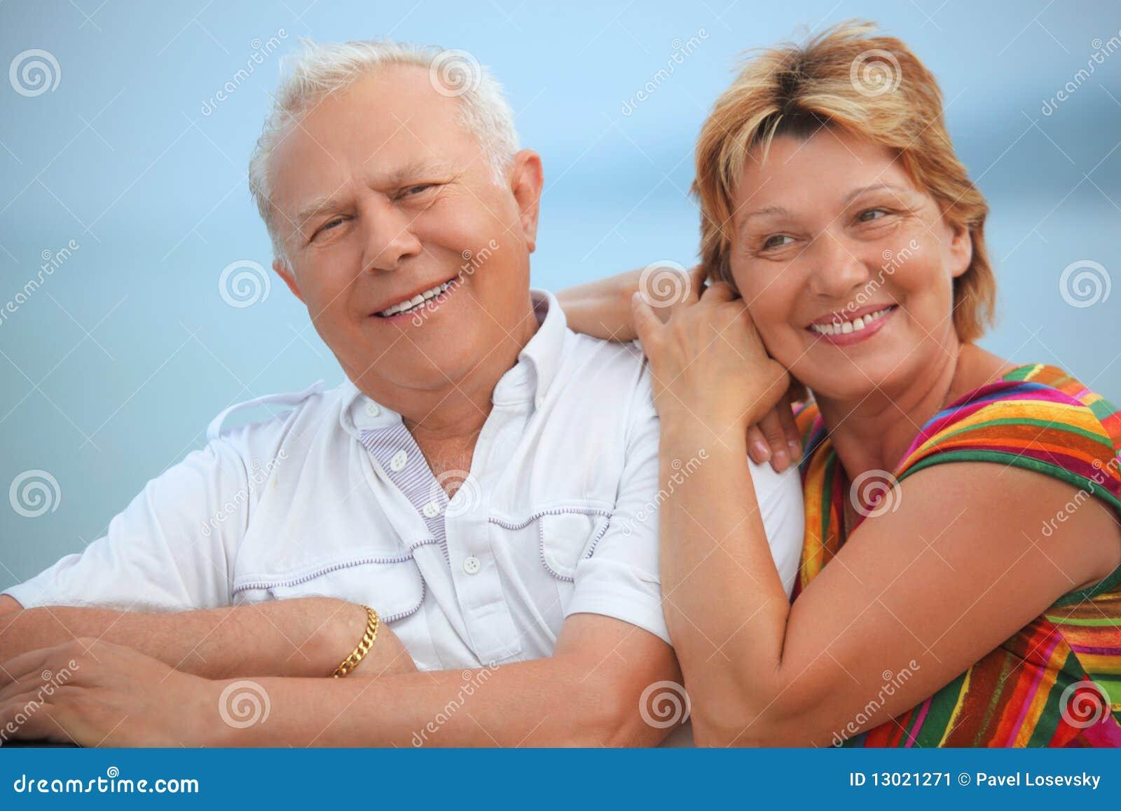 Smiling elderly married couple on veranda