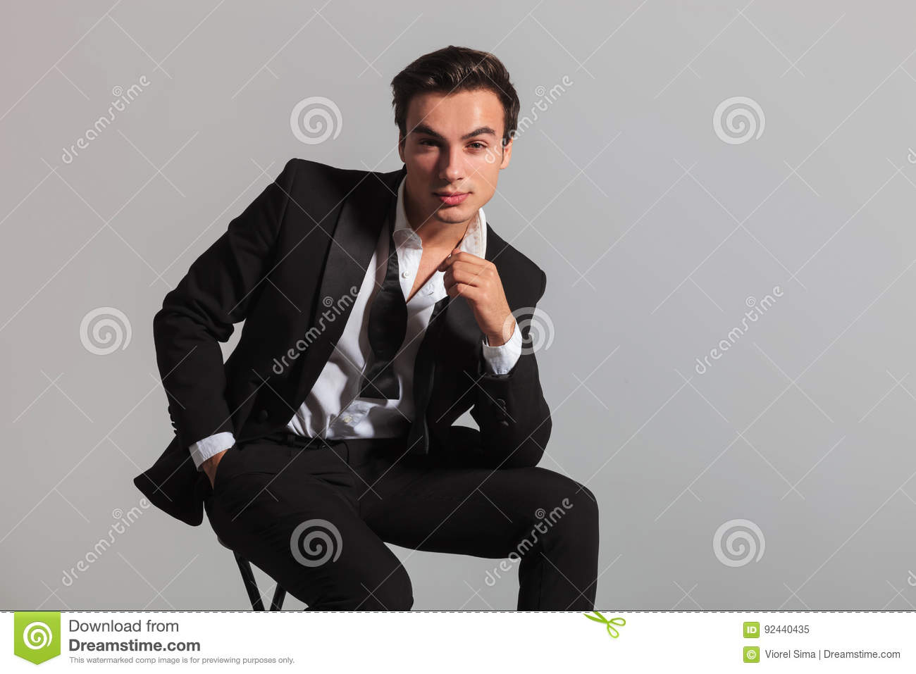 a380337fc929 Smiling Elegant Man In Tuxedo And Undone Bowtie Sitting Stock Image ...