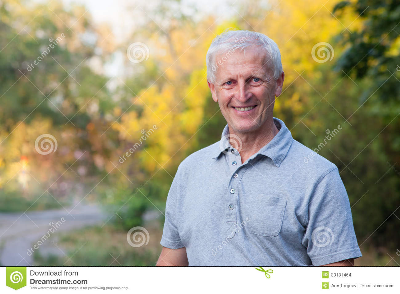 Portrait of happy smiling face of grey-haired old man  Outdoor  Blue    Old Man Face Smiling