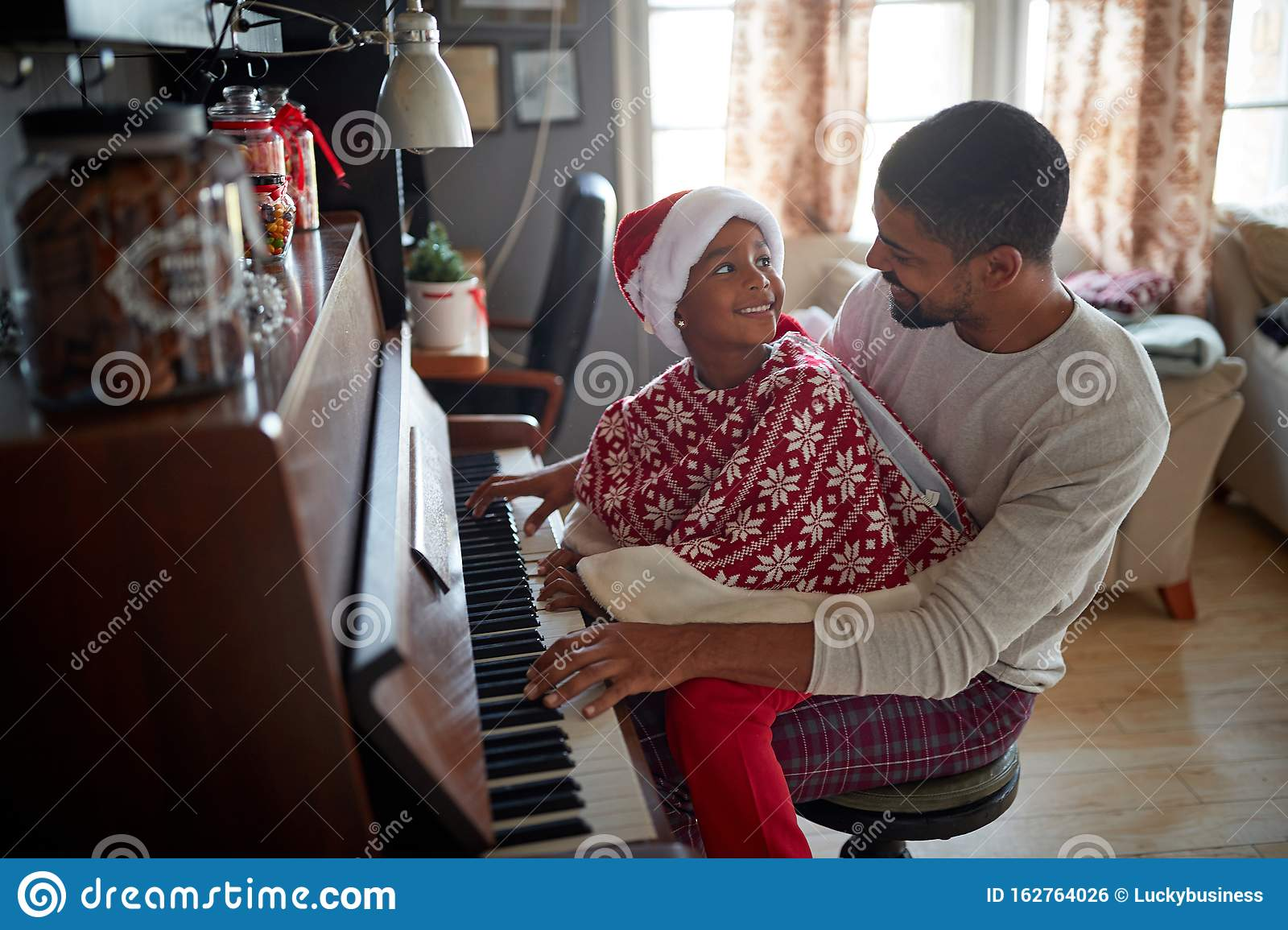 Family On Christmas Morning Play Music On Piano Stock Photo - Image of child, daughter: 162764026