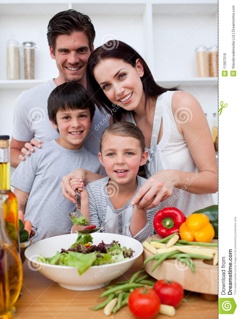 Smiling Family Cooking Together Stock Photo - Image of latin, hand: 11997018