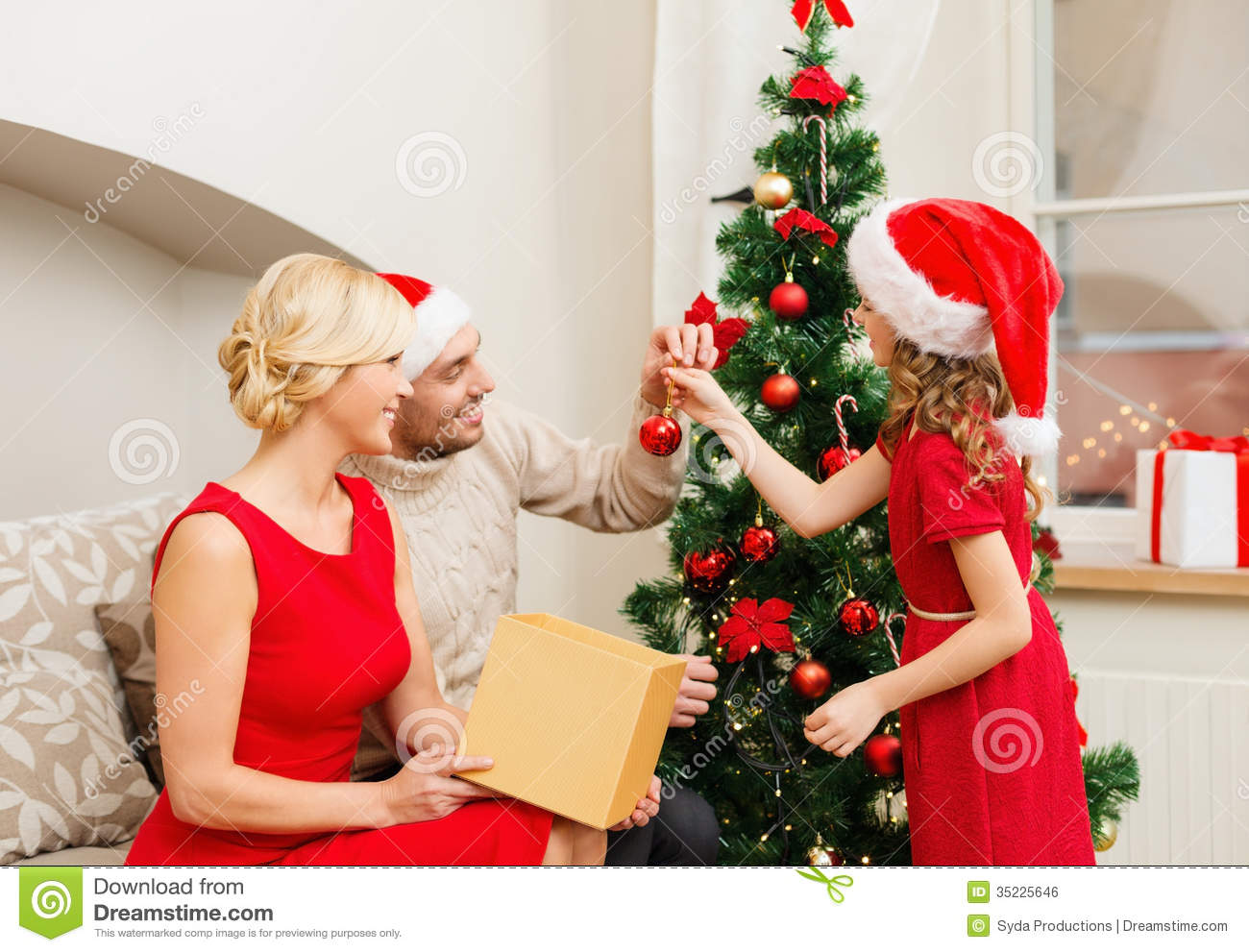 People Decorating A Christmas Tree smiling family decorating christmas tree royalty free stock image