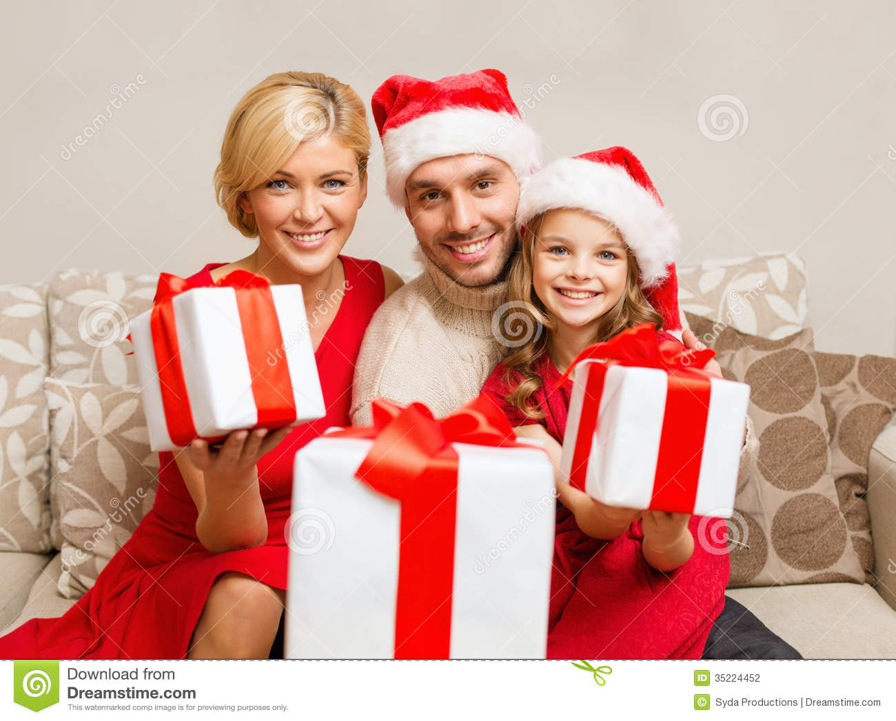 Family Christmas Gift Giving.Smiling Family Giving Many Gift Boxes Stock Photo Image Of