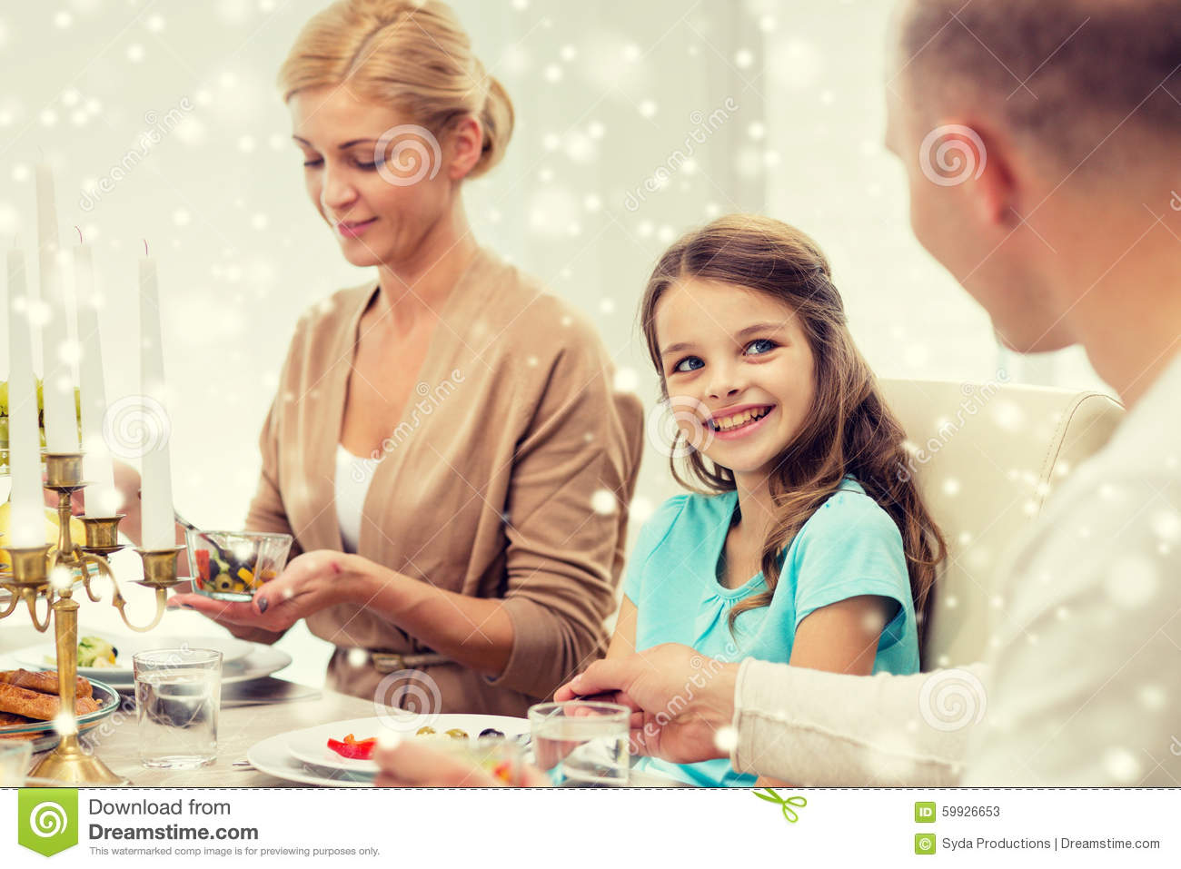 Smiling family having holiday dinner at home