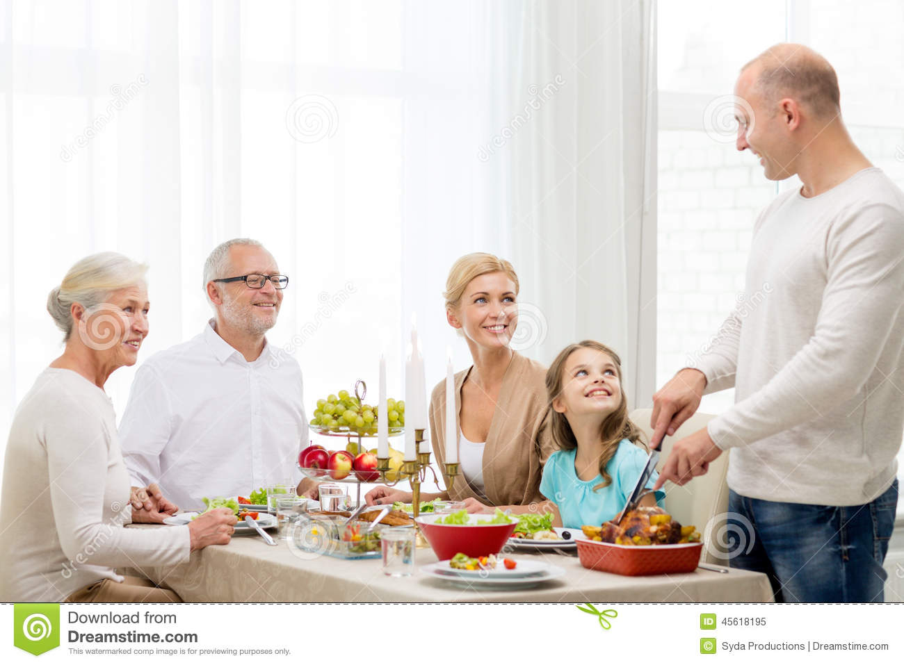 Smiling Family Having Holiday Dinner At Home Stock Photo ...