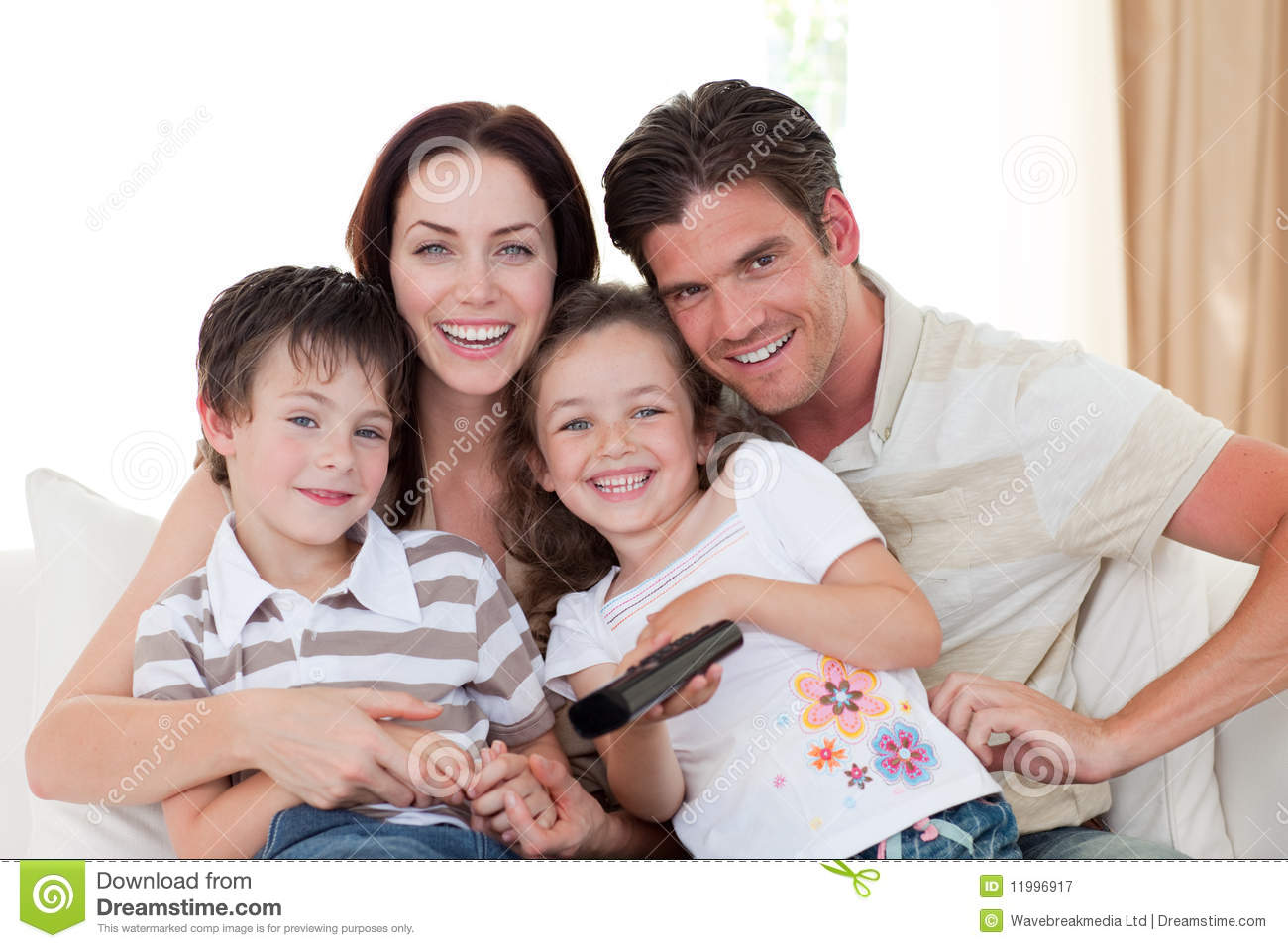 Smiling family watching tv in the living room royalty free for Family in the living room