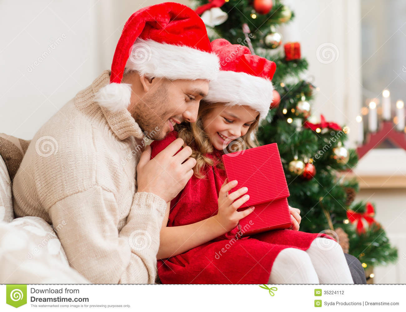Smiling Father And Daughter Opening Gift Box Stock