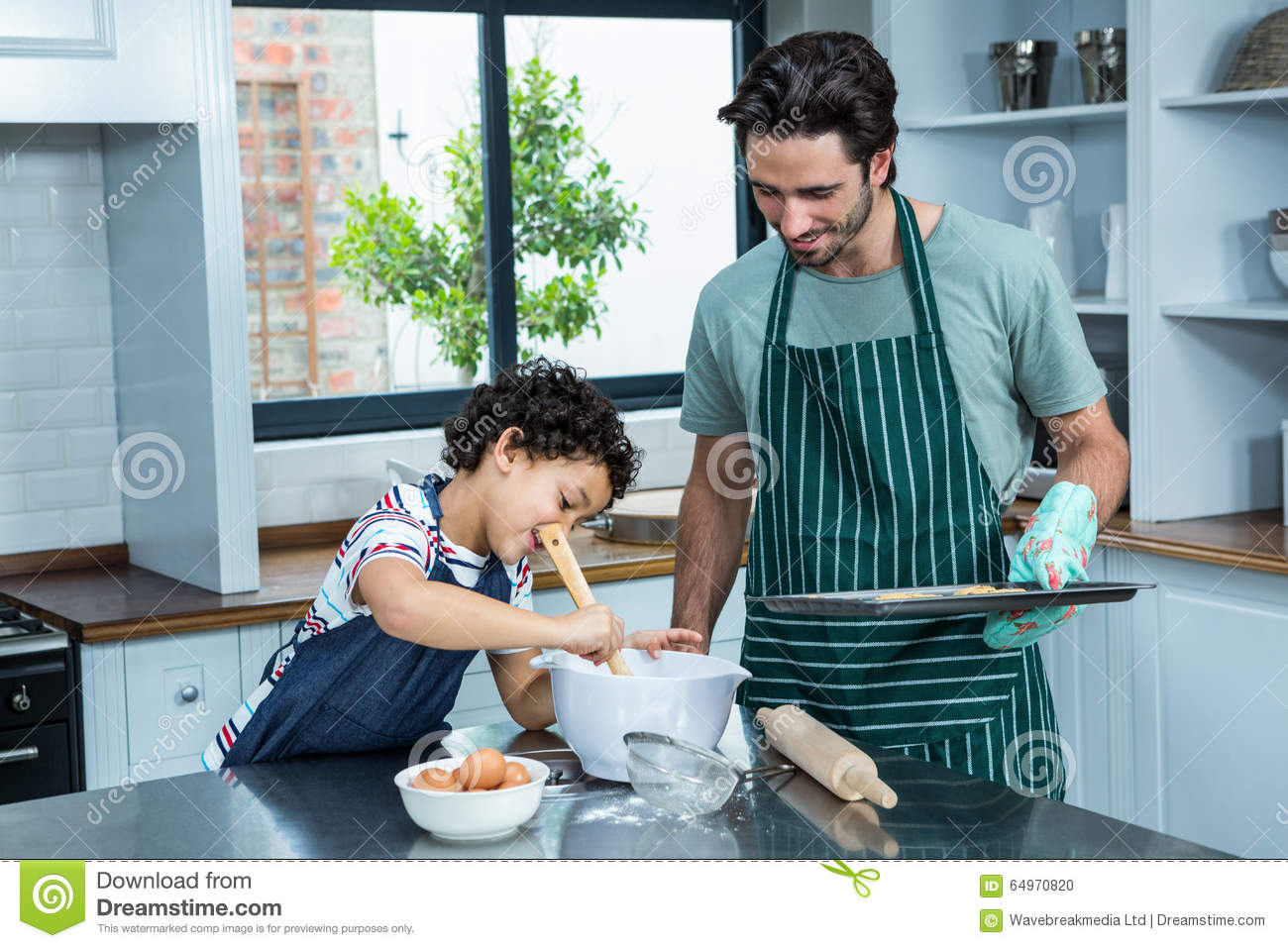 Smiling Father And Son Cooking Biscuits Stock Photo - Image of ...