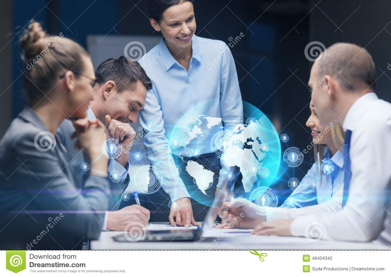 Technology Management Image: Smiling Female Boss Talking To Business Team Stock