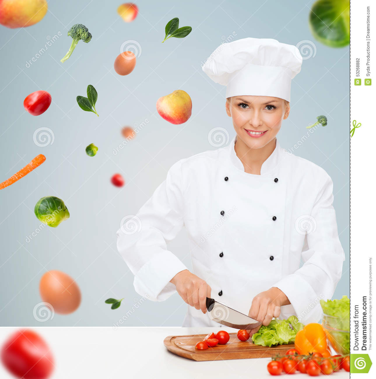 Smiling Female Chef Chopping Vegetables Stock Photo ...