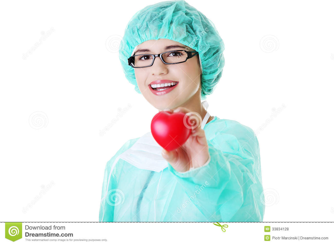 Smiling female doctor or nurse holding red heart