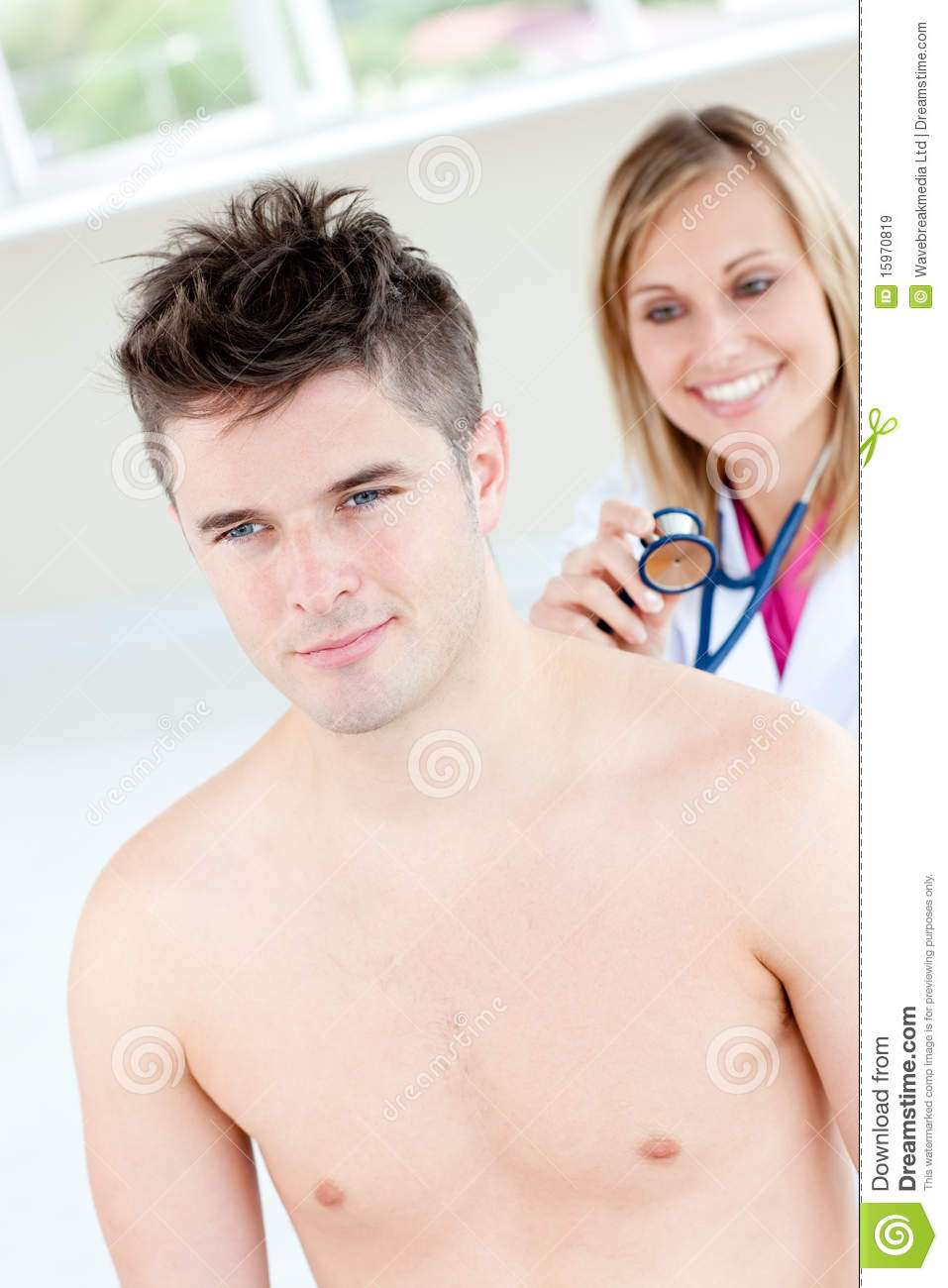 Smiling female doctor sounding her male patient in her office.