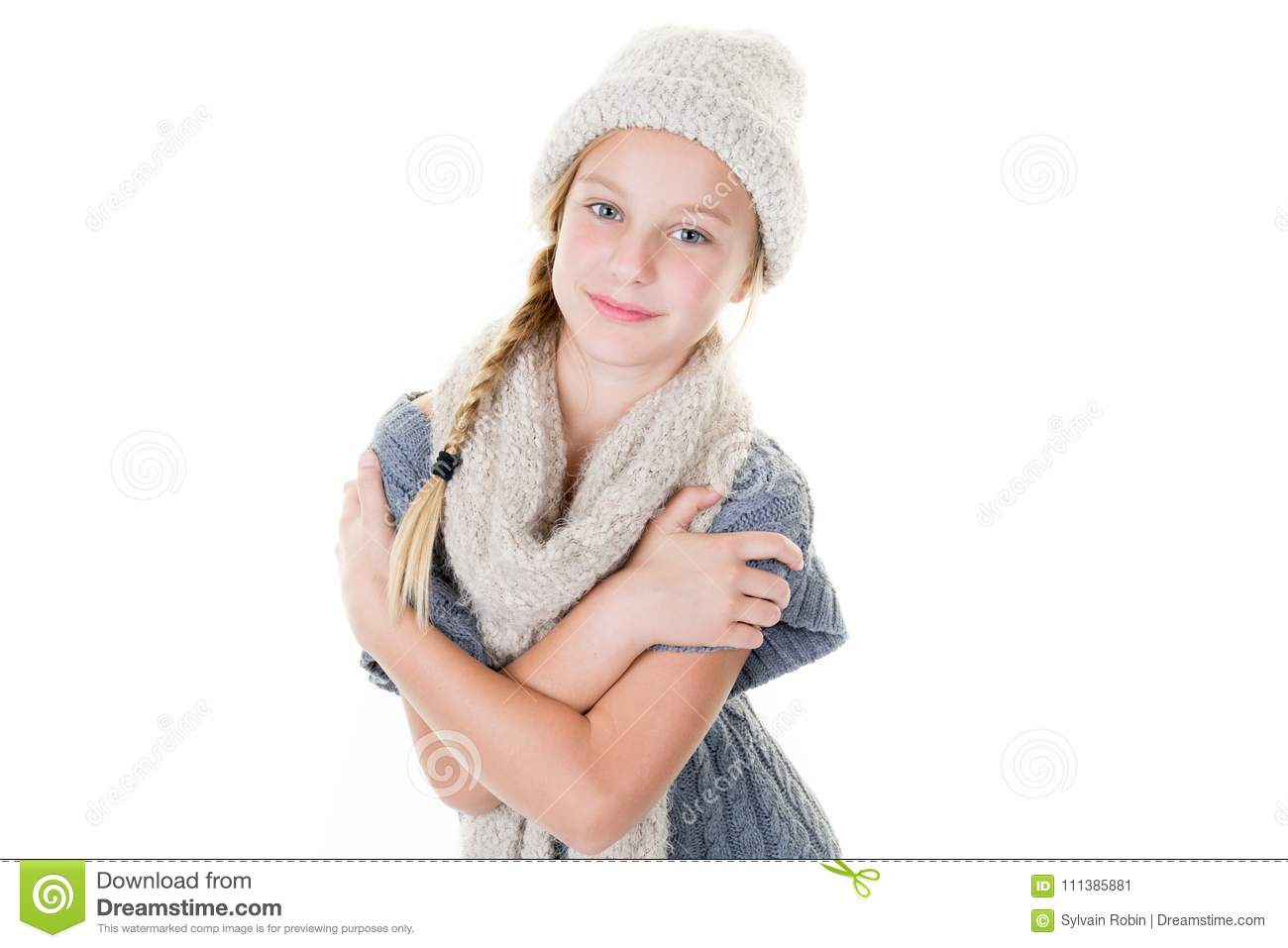 e0204d63cf5a Portrait of young smiling female girl standing with folded hands over white  background and scarf wool cap
