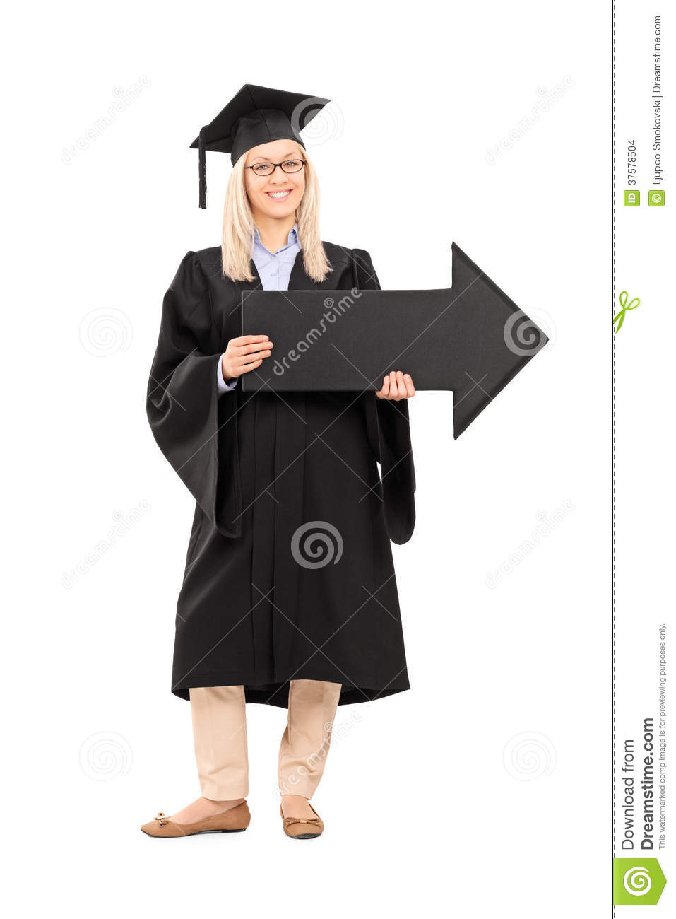 Smiling Female In Graduation Gown Holding A Big Black Arrow Stock ...