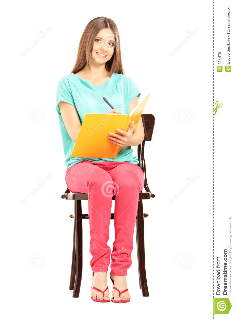 smiling female student sitting chair writing notes isolated white background 33447011 - Picking Uncomplicated Programs For coolessay net