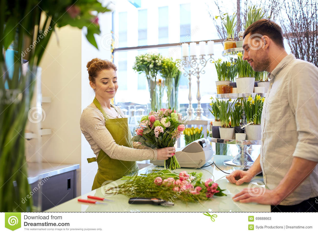 Smiling florist woman and man at flower shop stock image image of royalty free stock photo izmirmasajfo Gallery