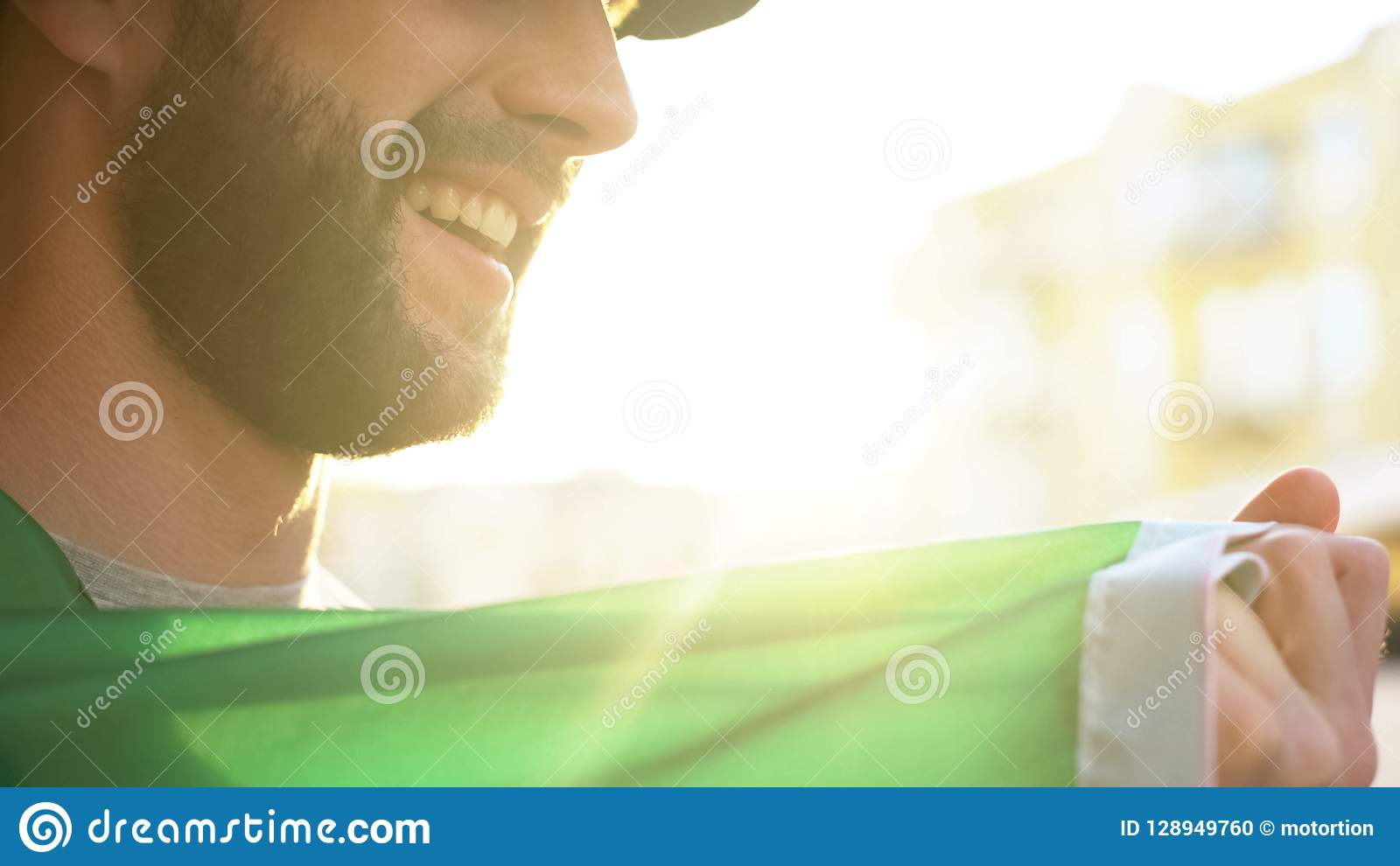 Smiling football supporter rejoicing victory of favorite team, watching match