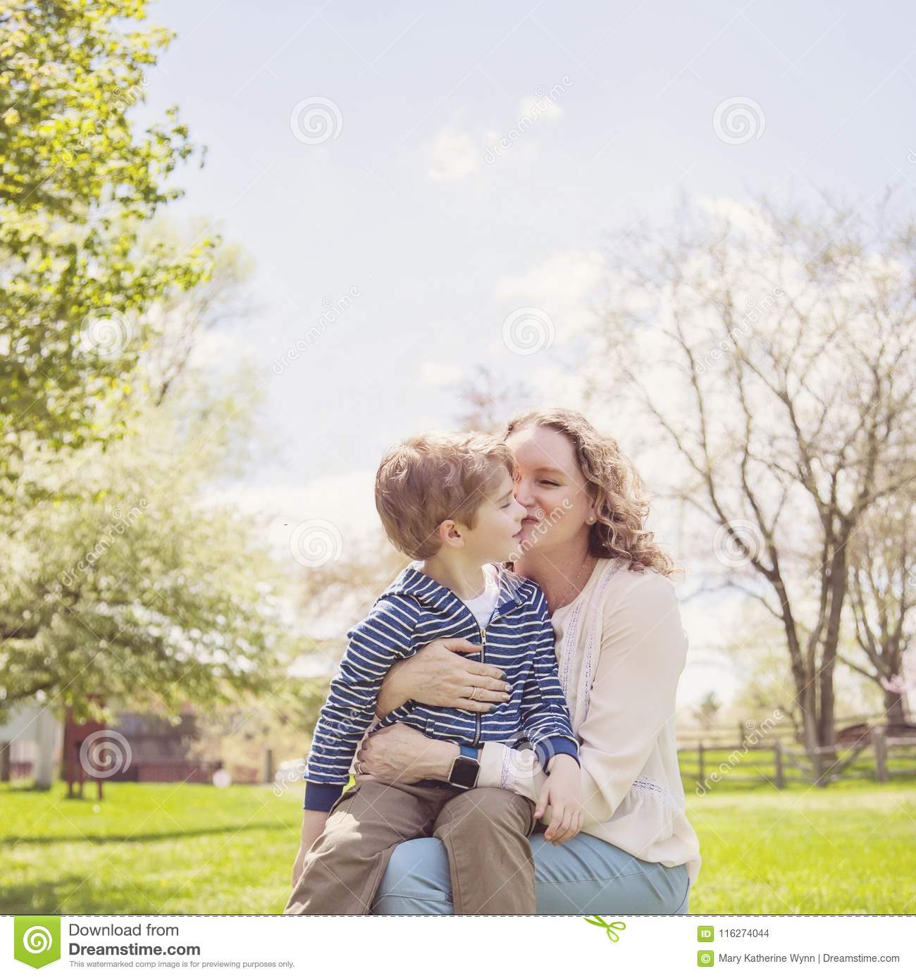 Happy Grandmother kissing grandson in park