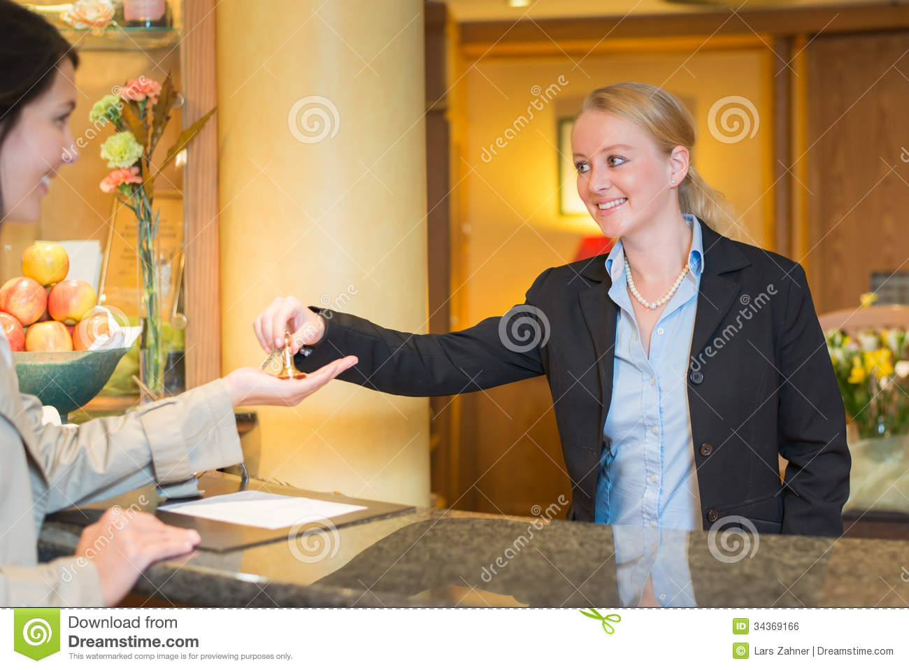 Smiling Friendly Hotel Receptionist Royalty Free Stock ...