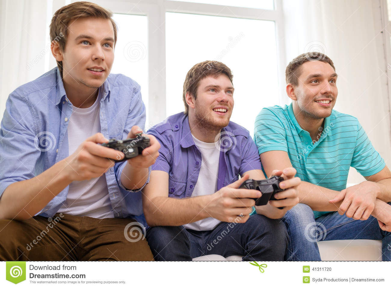 Smiling Friends Playing Video Games At Home Stock Photo ...