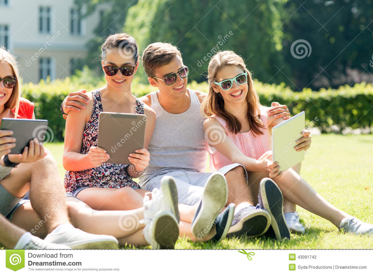 Download Smiling Friends With Tablet Pc Computers In Park Stock Photo - Image of making, friendship: 43091742