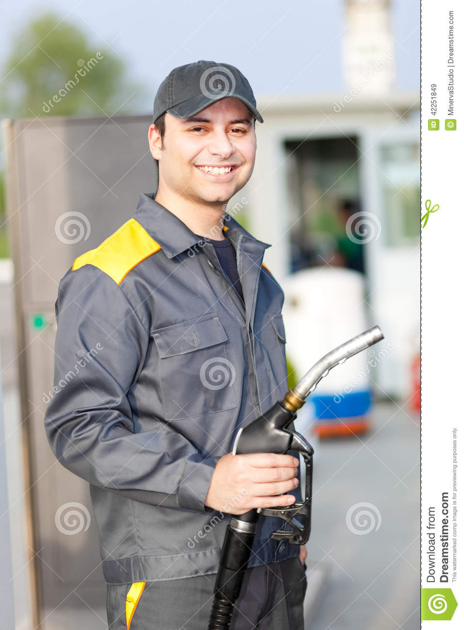 Smiling Gas Station Worker Holding A Fuel Nozzle Stock Photo ...