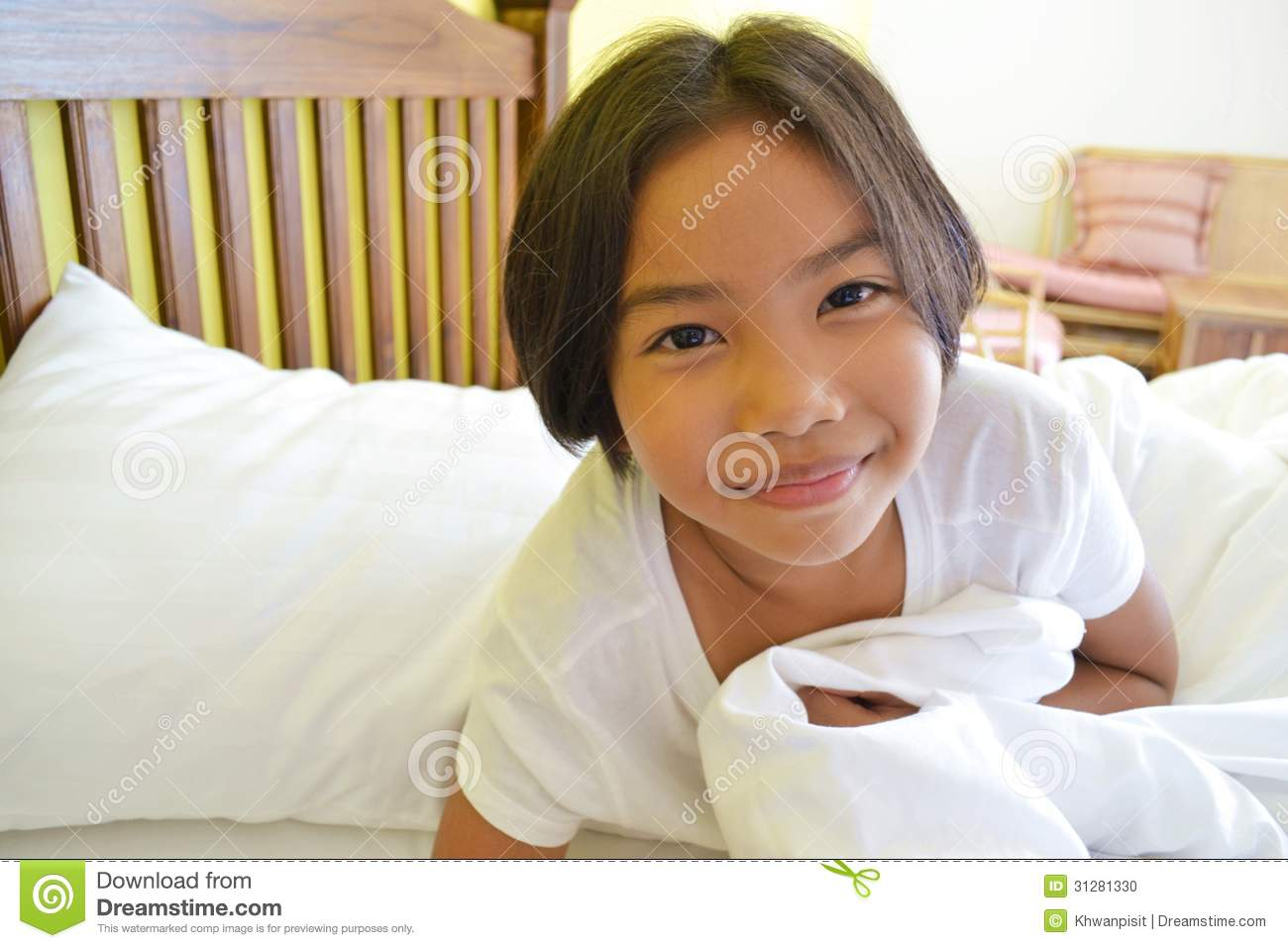 On The Bed Smiling Girl On The Bed Stock Photo Image 31281330