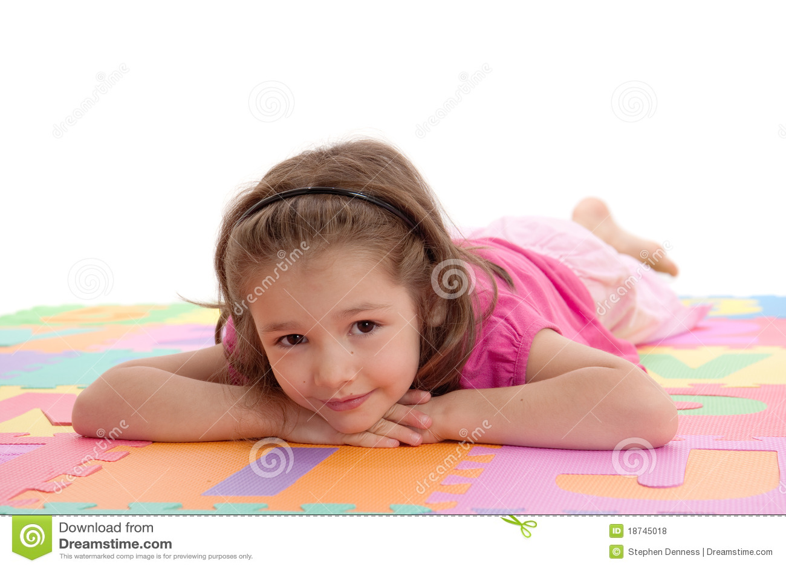 Smiling Girl Child Resting On Kids Alphabet Floor Royalty