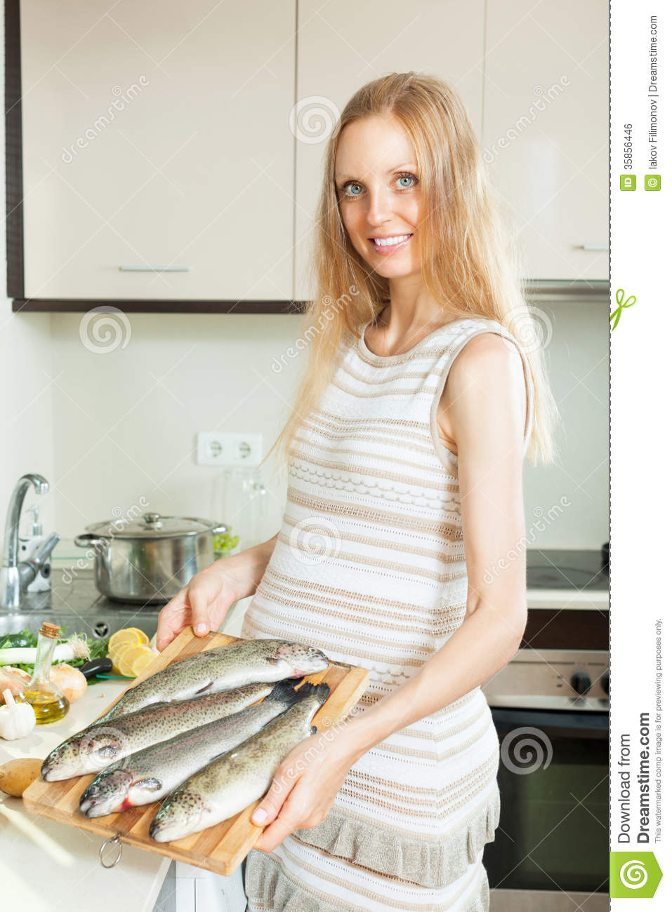 Fish frying in a pan with lemon royalty free stock for Fish dream meaning pregnancy