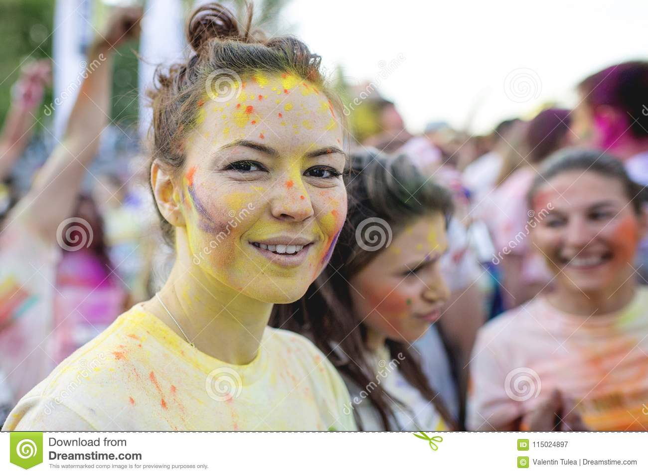 Smiling girl enjoying The Color Run Bucharest. Happiest 5k on the planet!