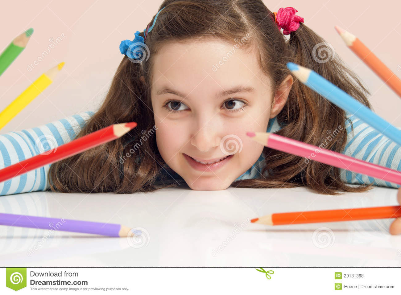 Smiling girl holding color pencils