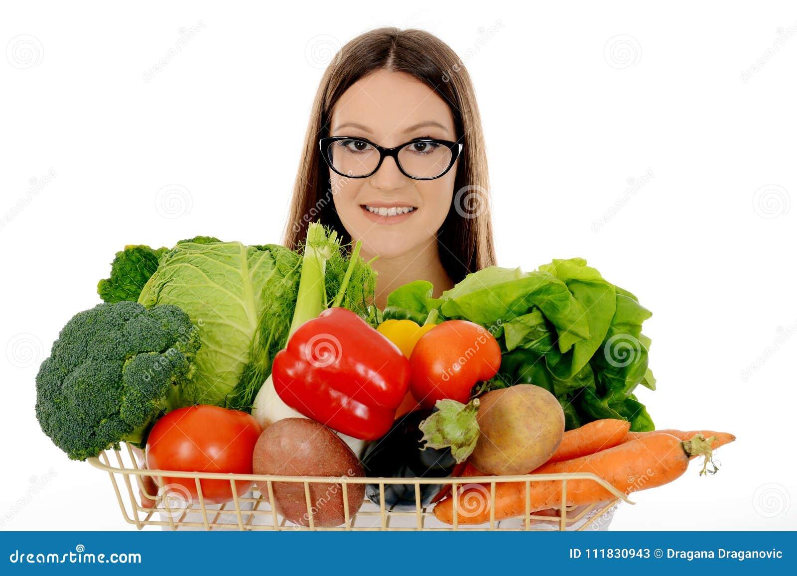 739cdd7e Smiling Girl Holding Vegetables, Pepper, Lettuce, Broccoli, Stock ...