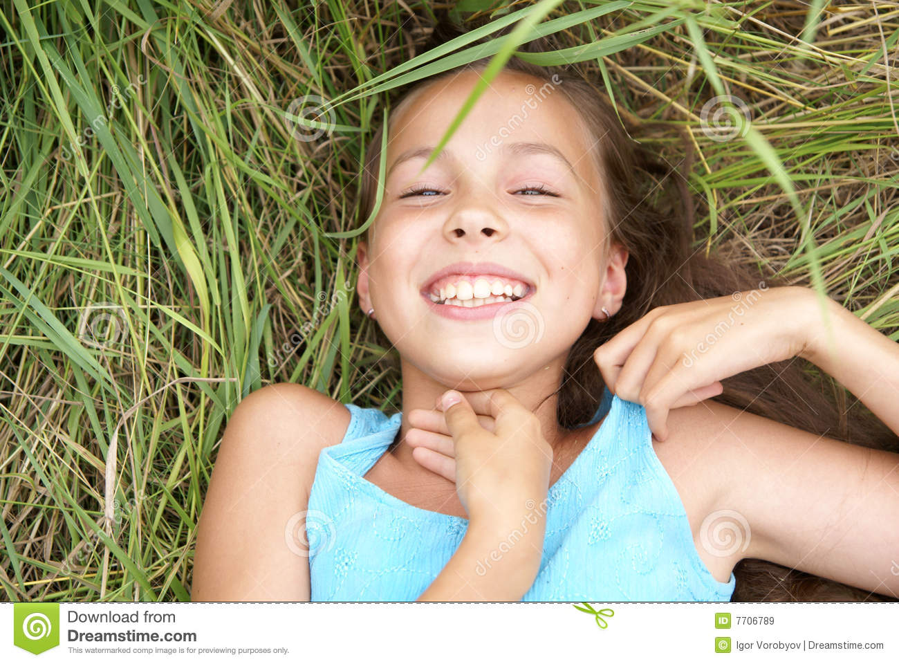 Preteen Girl In Green Grass Royalty Free Stock Photo