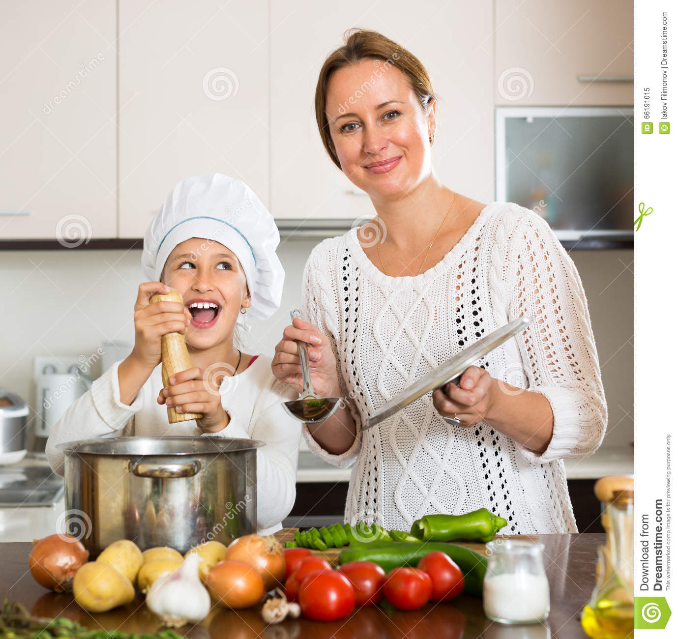 Smiling Girl And Mom At Kitchen Stock Image - Image of family ...