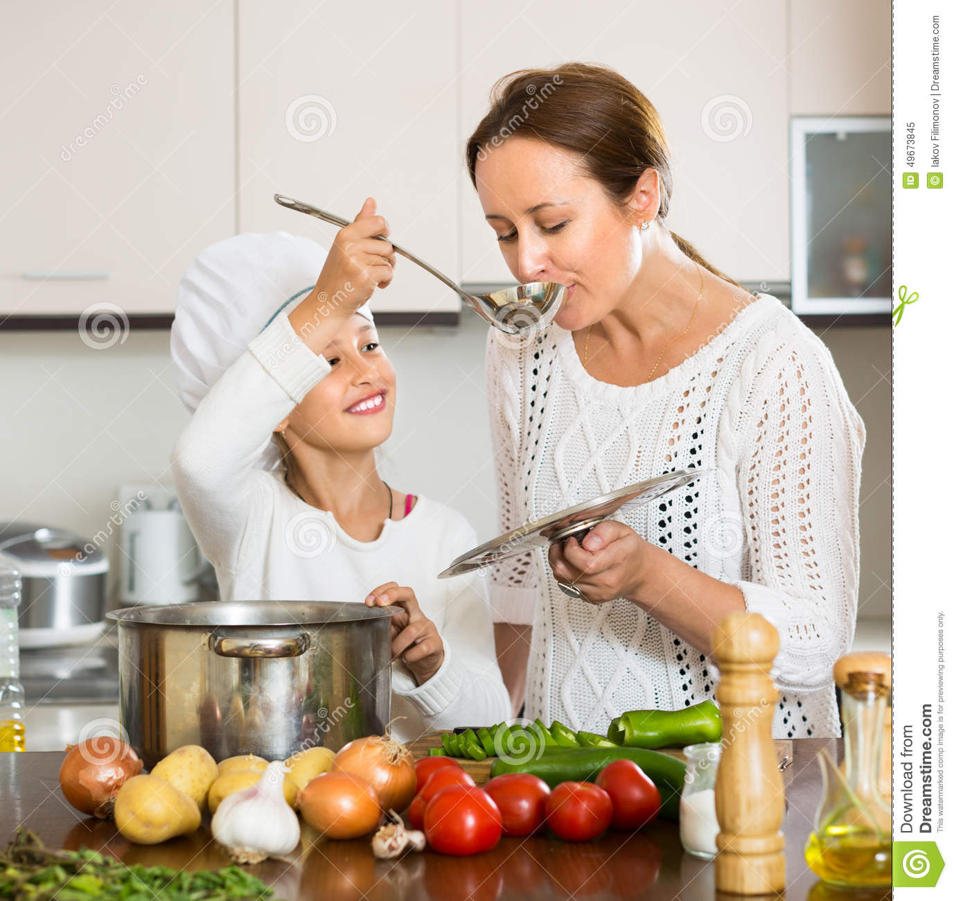 Smiling Girl And Mom At Kitchen Stock Image - Image of ladle ...