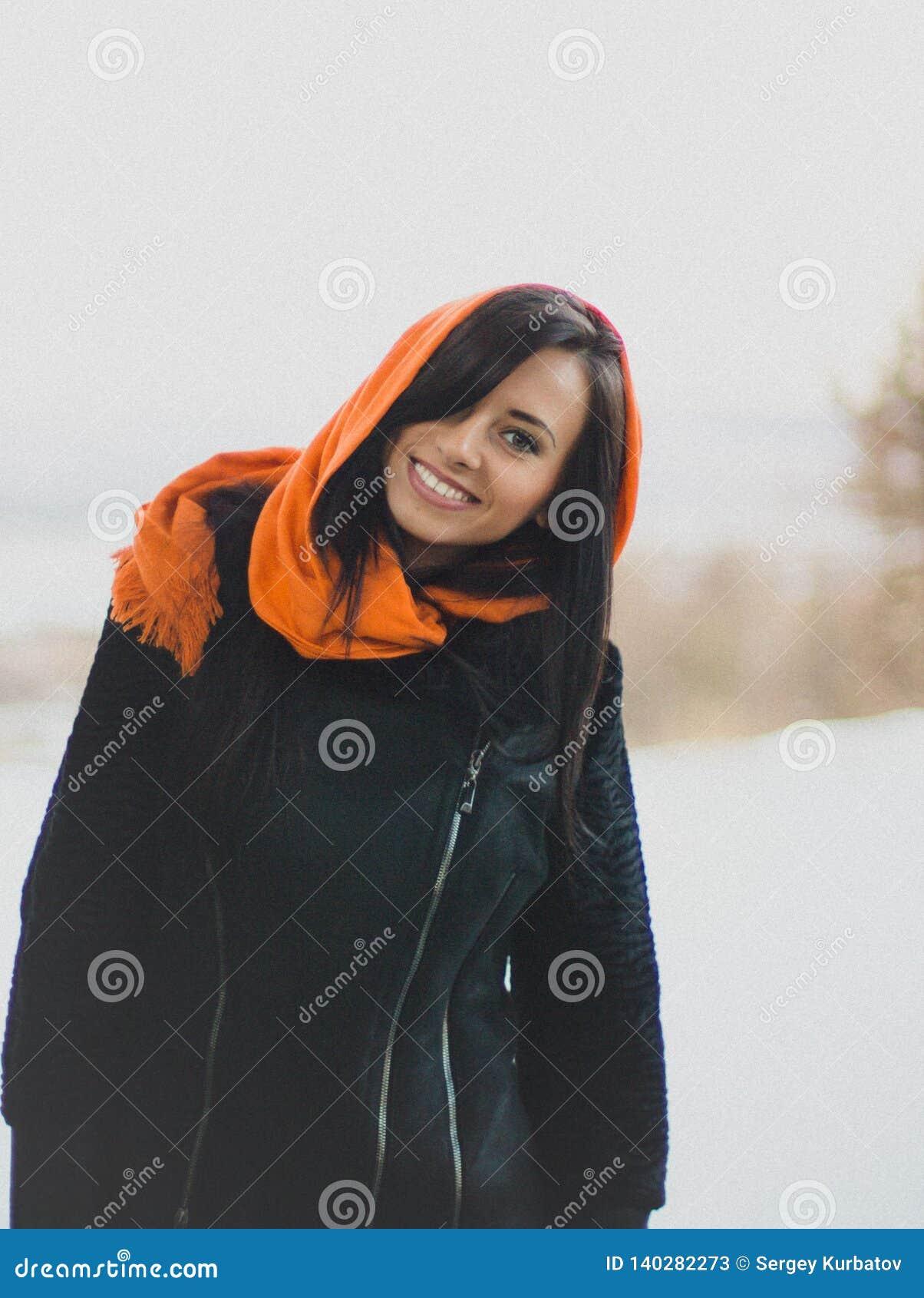 Smiling girl in orange hijab