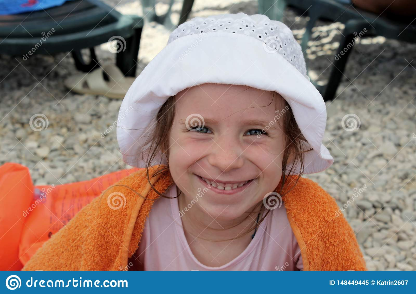 Smiling girl in orange towel